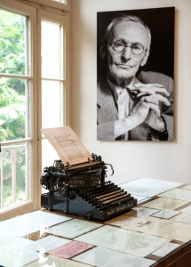 MONTAGNOLA, SWITZERLAND - AUGUST 28, 2012: portrait and original typewriter in Herman Hesse museum in Montagnola, where famous poet and writer 1931–1962 lived. August 28, 2012 Montagnola, Switzerland